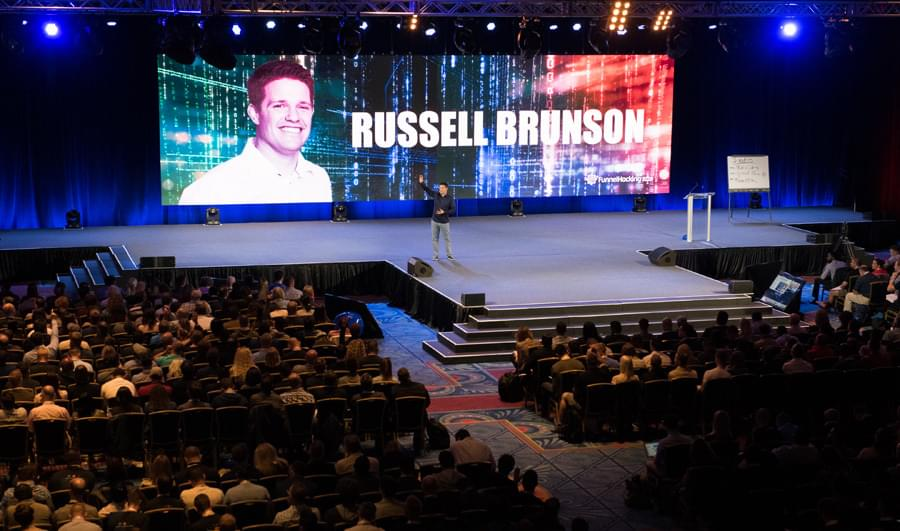 Russell brunson secrets presentation on the stage